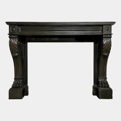 A Large French Empire Black Marble Fireplace Mantel