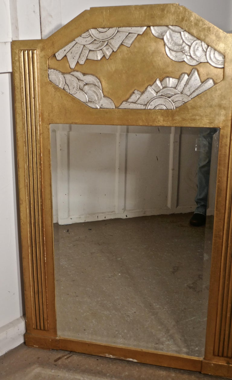 Early 20th Century Large French Odeon Style Art Deco Gilt Wall Mirror For Sale