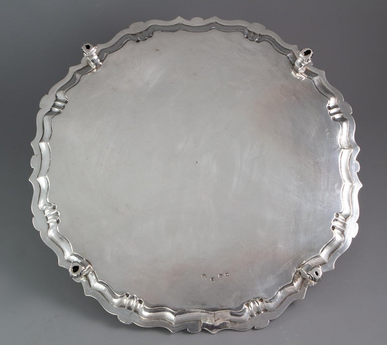 A large and impressive George II octagonal silver salver with pie crust edge and shell decoration. The central plate engraved with cornucopia of fruits and flowers amidst patterned arabesques. The centre engraved with an armorial beneath a crown.