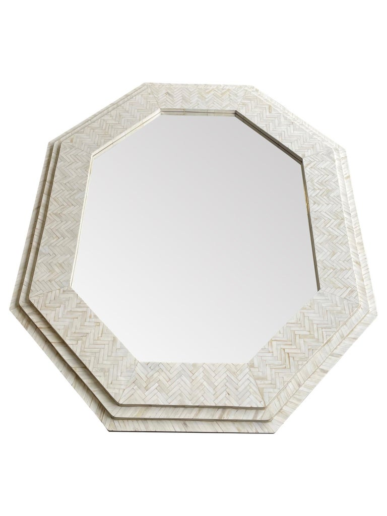 A large handmade inlaid bone octagonal mirror in the style of Enrique Garcel.