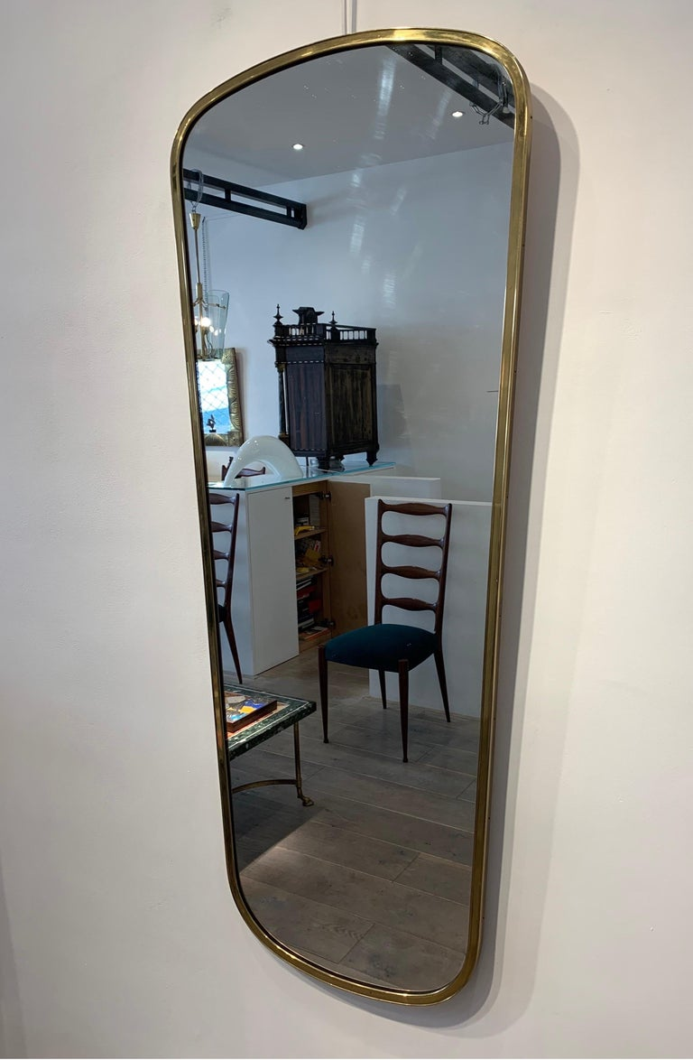 The mirror is the style of Gio Ponti mirror. It has its beautiful patina of the time. The size is larger than usual mirror f of this type with a height of 135cm.
