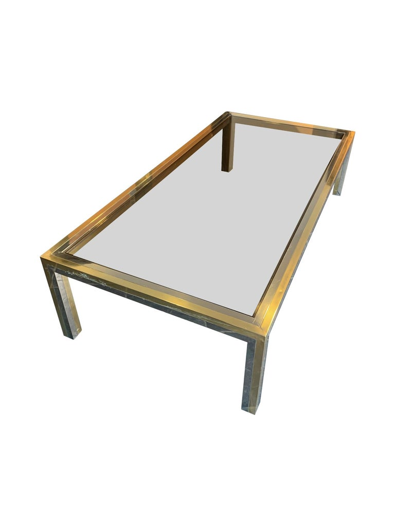 A large 1970s Italian Romeo Rega chrome and brass coffee table with smoked glass top.