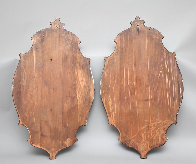 A large pair of 19th century walnut Black Forest wall plaques of superb quality, the oval and carved shaped plaques depicting beautifully detailed game birds and various foliage, circa 1880.