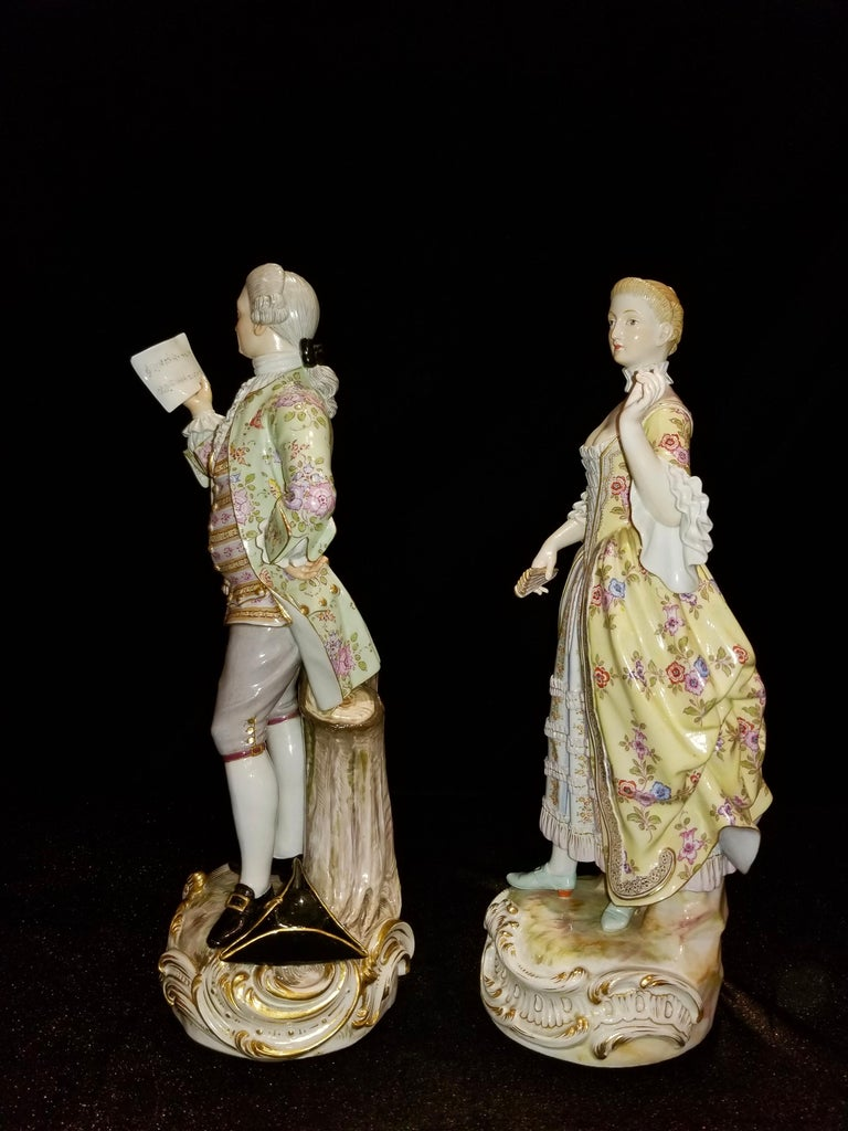 A beautiful and quite large pair of 19th century Meissen porcelain figures of Lovers Singing. Each figure is beautifully decorated and hand-painted. The gentleman is wearing a three-piece suite with a vibrant green jacket decorated with flowers and