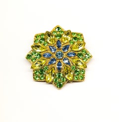 A large paste and gilt metal  'star' brooch, Yves Saint Laurent, France, 1980s