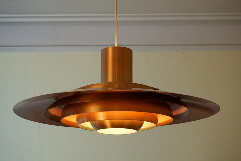 A rare and giant Version of Preben Fabricius & Jorgen Kastholm Mod. P700 pendant in copper finish for Nordisk Solar, Denmark, in a slightly patinated condition but still very beautiful and a stunning piece for a big round dining table for