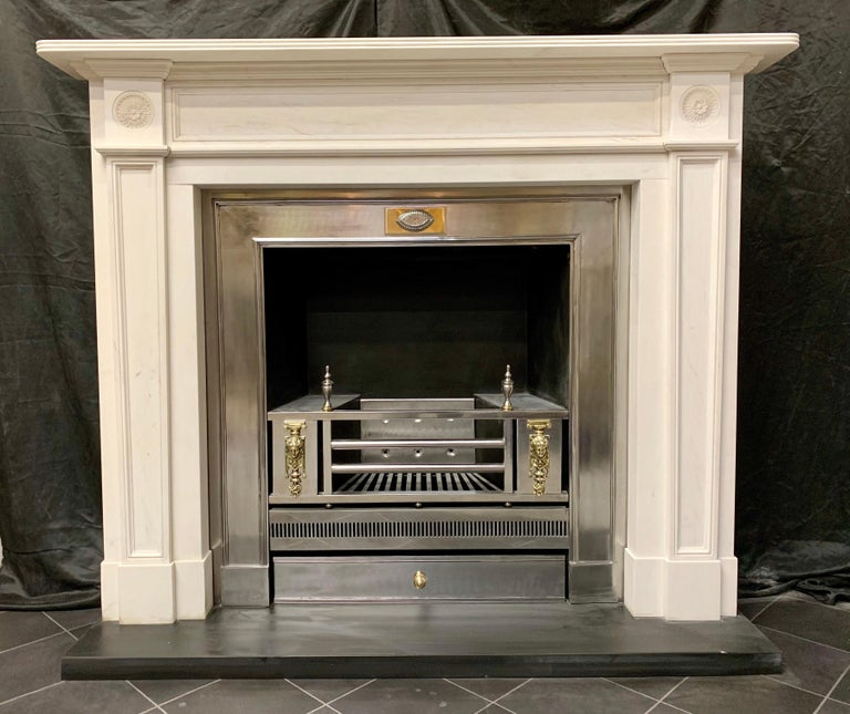 A large and impressive, in immaculate condition a Regency style lightly veined Statuary marble fireplace surround, an elegant reeded shelf sits above a recessed and panelled and beaded freeze with a fine cut moulding wrapping around the top section,