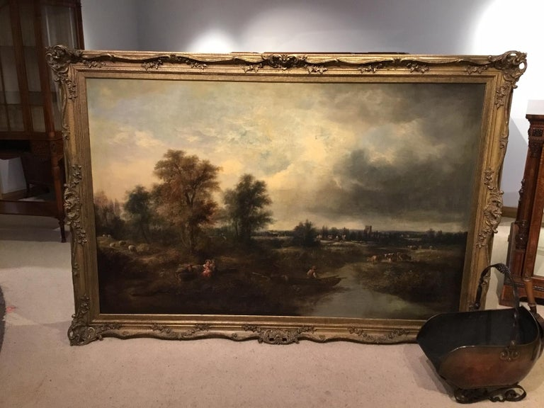A large scale 19th century rural landscape oil painting in the style of Constable depicting a typical rural scene with cattle, children playing and a fisherman on the river under summer skies, housed in a modern Double swept carved gilt wood frame.