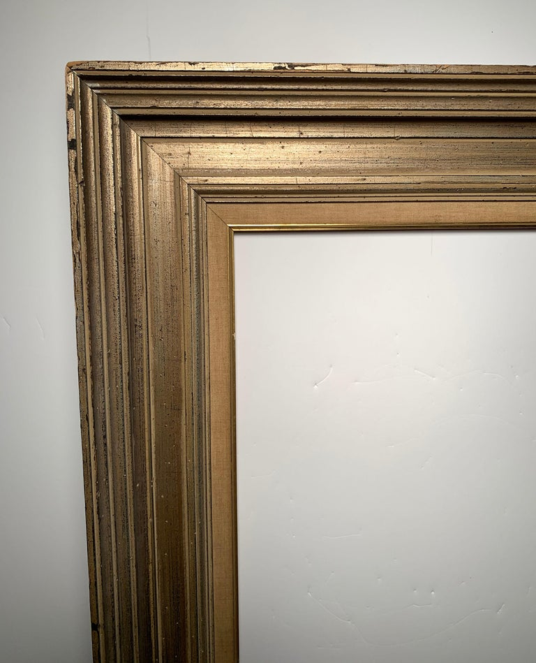 A large vintage Armand Lee matte silver mirror or picture frame. Manner of La Barge  Armand Lee, a salesman for Mueller Brothers Frame Manufacturing, opened Armand Lee & Company in the early 1940s. The company catered to the under-served interior