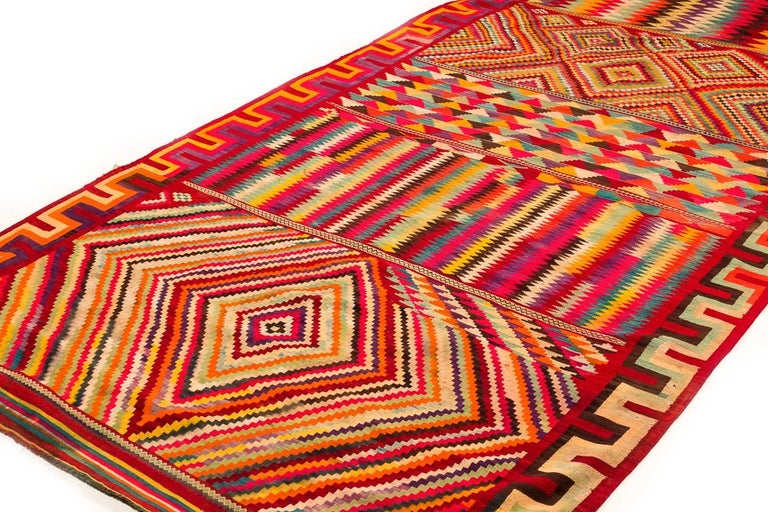 An incredible eye dazzler of a Kilim. This Algerian Kilim represents a rare type. The colors and pattern are breathtaking. Woven from excellent native wool.