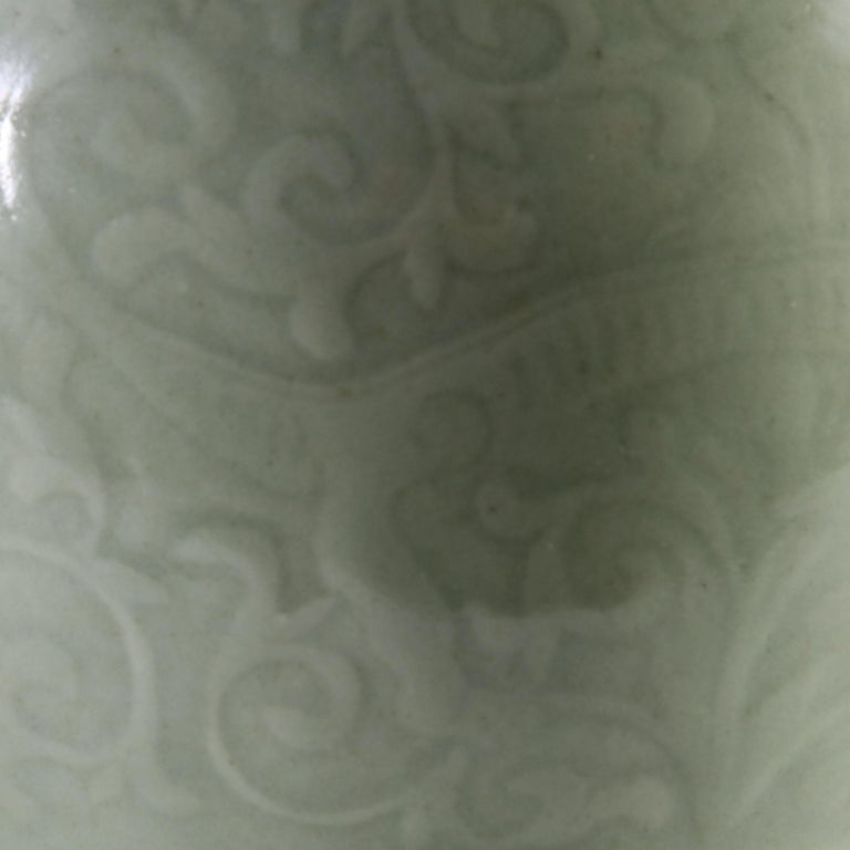 A late 19th century single Celadon vase with foliate decoration, now converted as a lamp.  Please note: lampshade not included.  Currently wired for the UK.