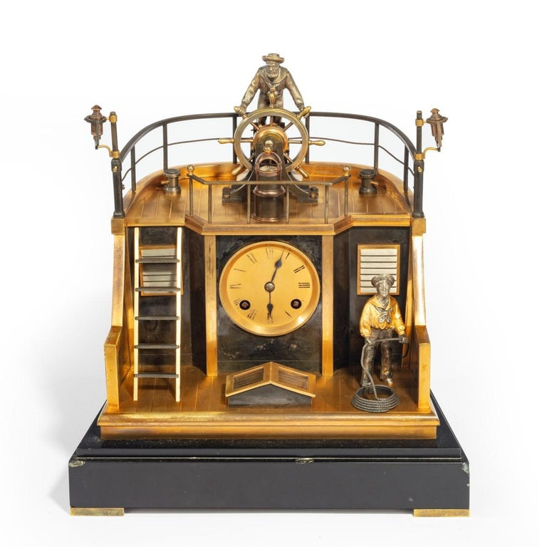 A late 19th century French gilt-brass and steel novelty 'quarterdeck' mantel clock by Guilmet, Paris, the eight-day gong striking movement with anchor escapement, circular gilt Roman numeral dial with steel spade hands, the case made as the stern of