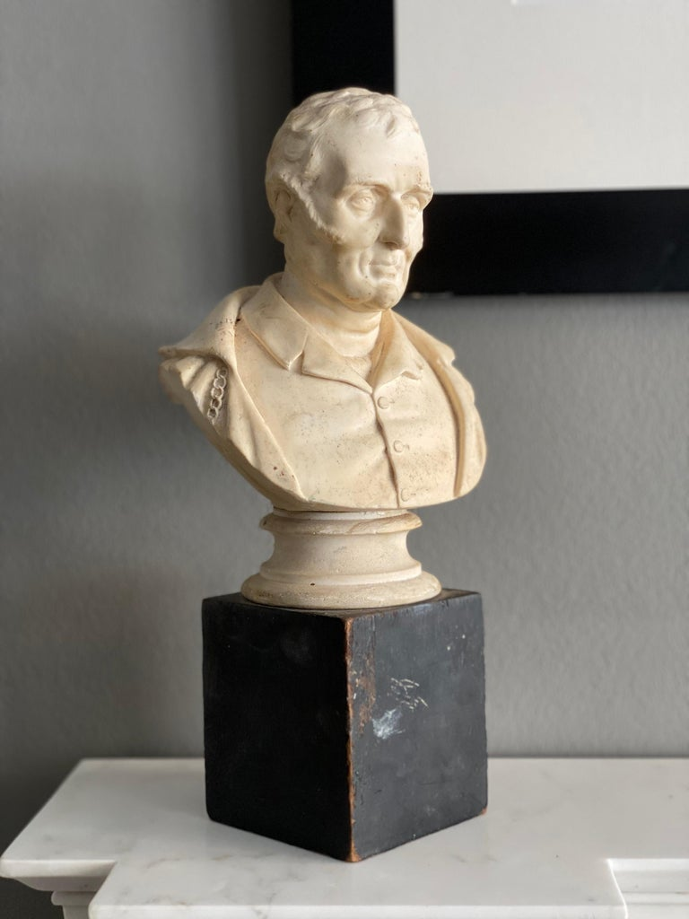 A late Victorian plaster bust of The Duke of Wellington mounted on a simple wooden block.
