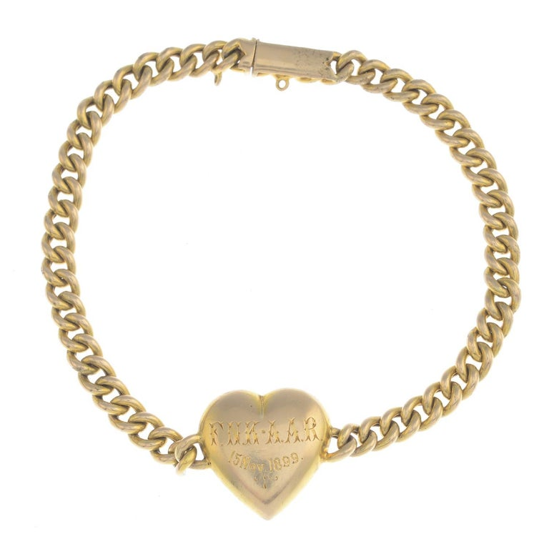 The pave-set split pearl heart, to the integral curb-link chain . Length 18cms. Weight 9.3gms. Engraving to reverse reads 'F.N.K · A.A.R 15 Nov 1899'. Split pearl panel is testing as 15ct gold.