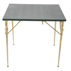 A Leather Top And Brass Folding Games Table