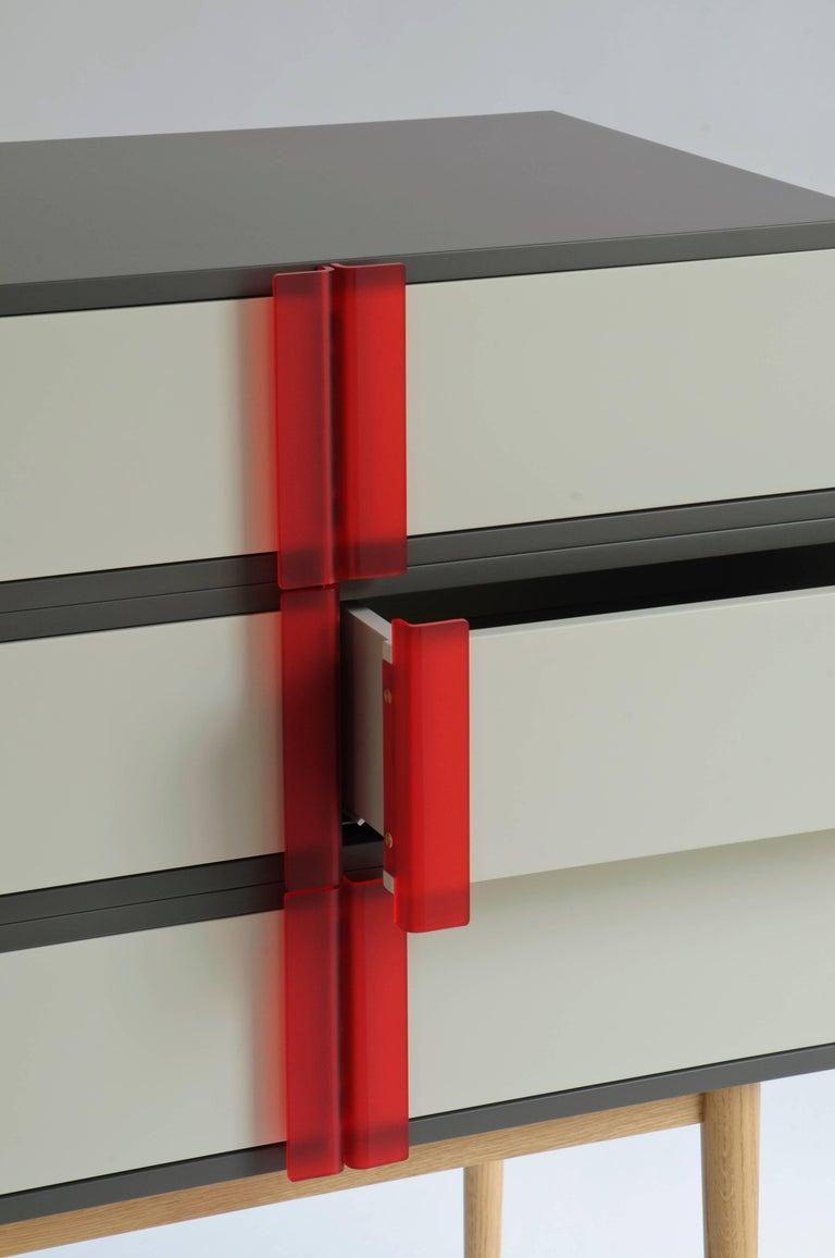 Plexiglass A-Line Dresser, dark and soft Gray Minimalist sculpture, Red Opalescent Handles For Sale