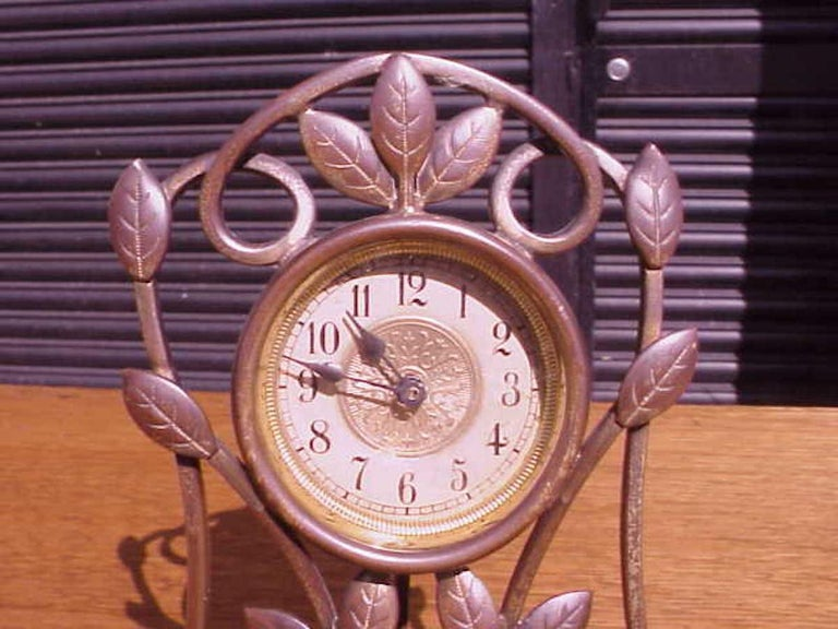 A little Arts and Crafts mantle/bedside clock with hand formed copper leaves.