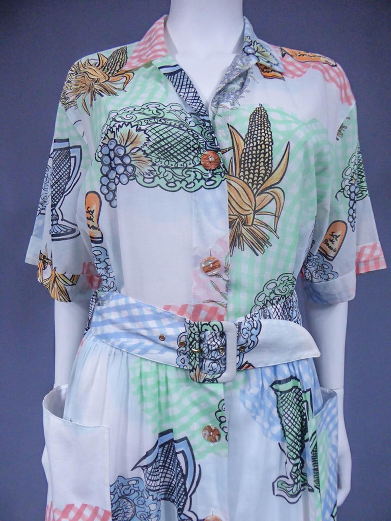 Circa 1970 France  Dress in printed polyamide in the provençal style by Louis Féraudand dating from the 1970s. Short-sleeved model, a matching belt buckle and a wide skirt lining. Opening on the front with matching resin buttons. Provencal