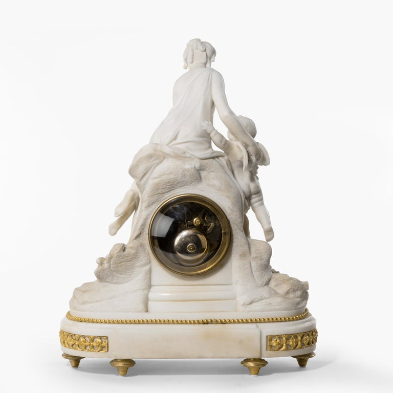 French Louis XVI Period Carved Marble Clock by Bruel of Paris For Sale