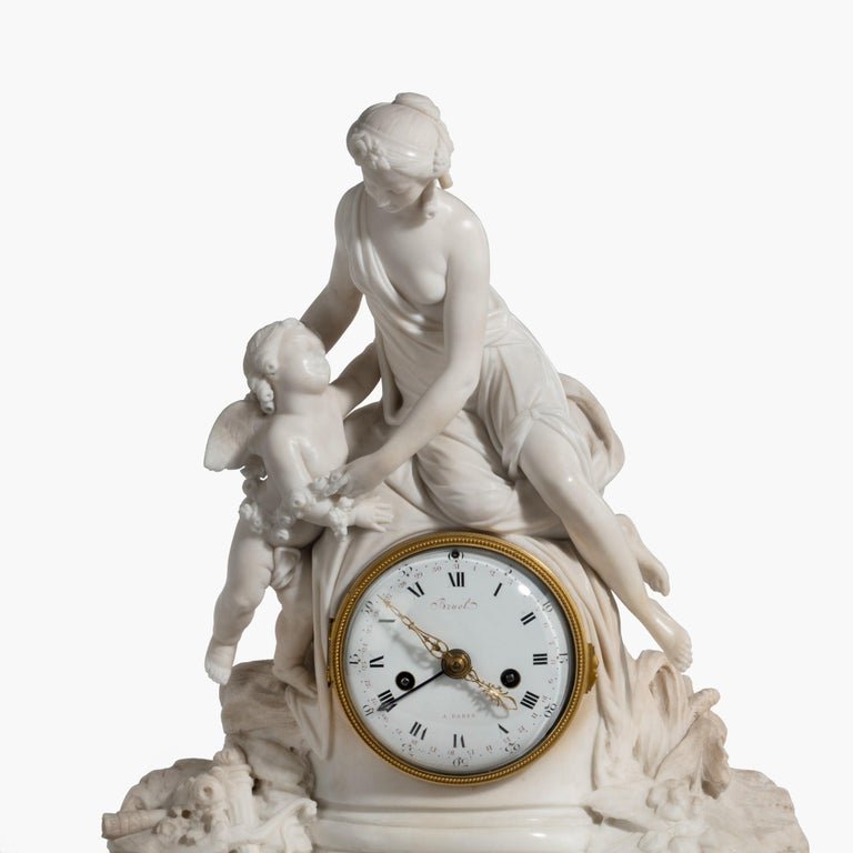 Late 18th Century Louis XVI Period Carved Marble Clock by Bruel of Paris For Sale