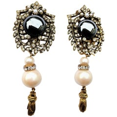 A lovely long pair ear clips with rhinestones, pearl and tassel