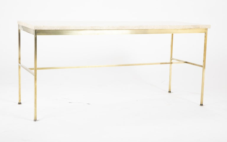 A square brass armature console table with travertine marble top designed by Paul McCobb.