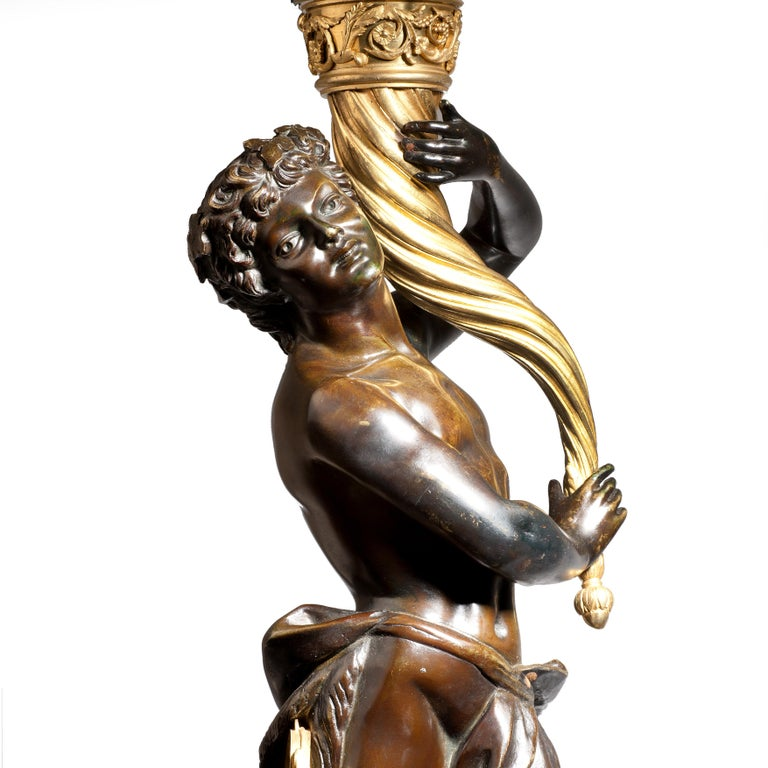 Bronze Magnificent Pair of Louis XVI Candelabra after Clodion For Sale
