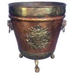 A Massive English Brass and Copper Log Bin with Armorial Crests