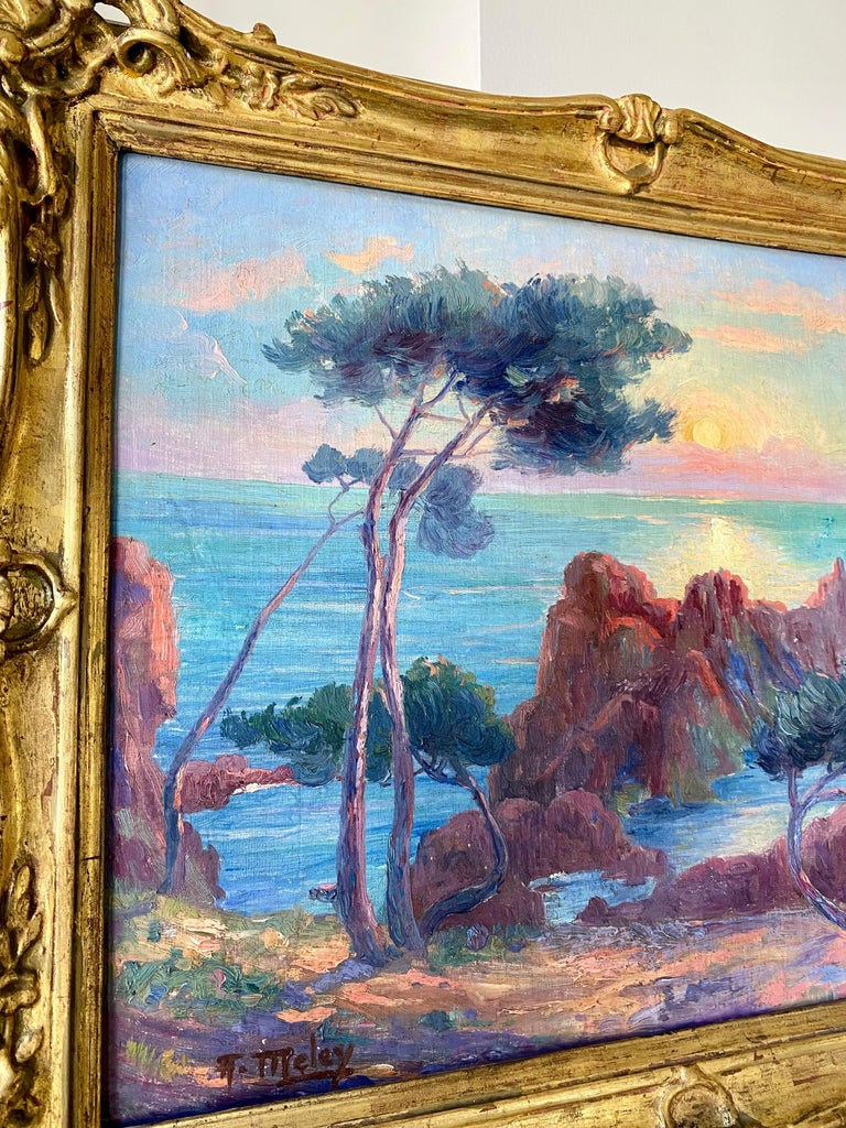 Wonderful and vibrant French 19th century impressionist painting depicting a magnificent sunset over the Mediterranean.   On a warm summer day, the painter captured this beautiful scenery from an elevated viewpoint on a rock high above the calm sea.