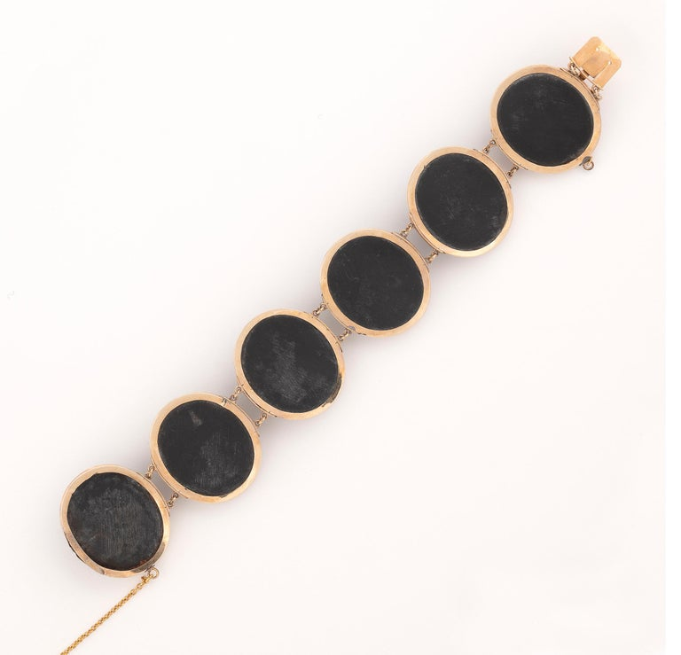 The bracelet composed of six oval plaques with classical busts in high relief circa 1860, bracelet 17.5cm long