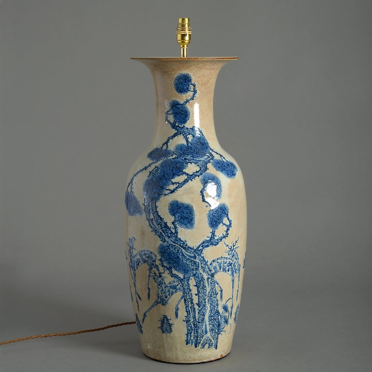 A tall mid-19th century crackle glazed porcelain baluster vase, with blue and café au lait decoration.  Late Qing dynasty  Dimensions refer to vase excluding shade and electrical components.