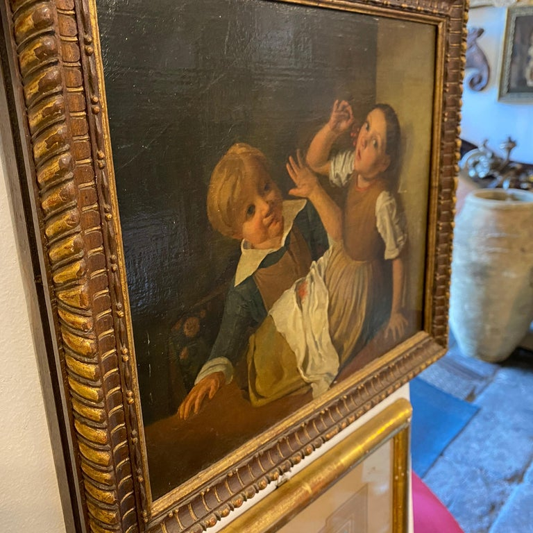 Mid-19th Century Giltwood Framed Painting Depicting Two Childs Eating Grape In Good Condition For Sale In Aci Castello, IT