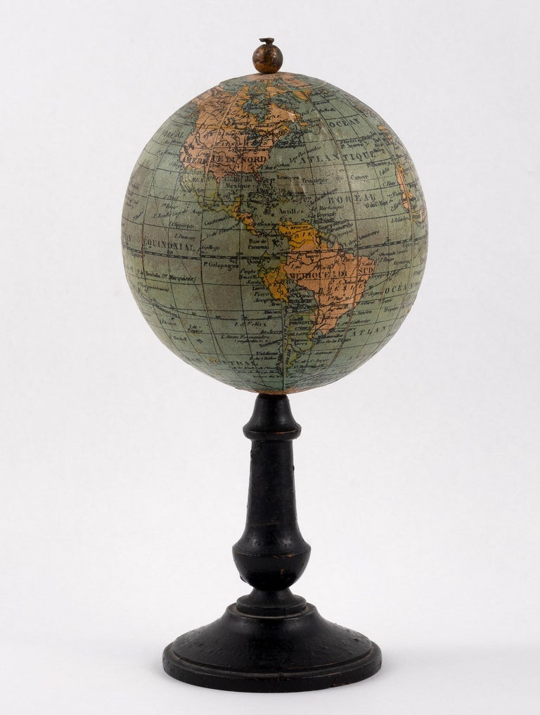 On turned wooden stand, 7.5cm diameter x 16cm high.