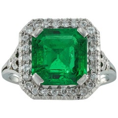 Mid-20th Century Emerald and Diamond Cluster Ring