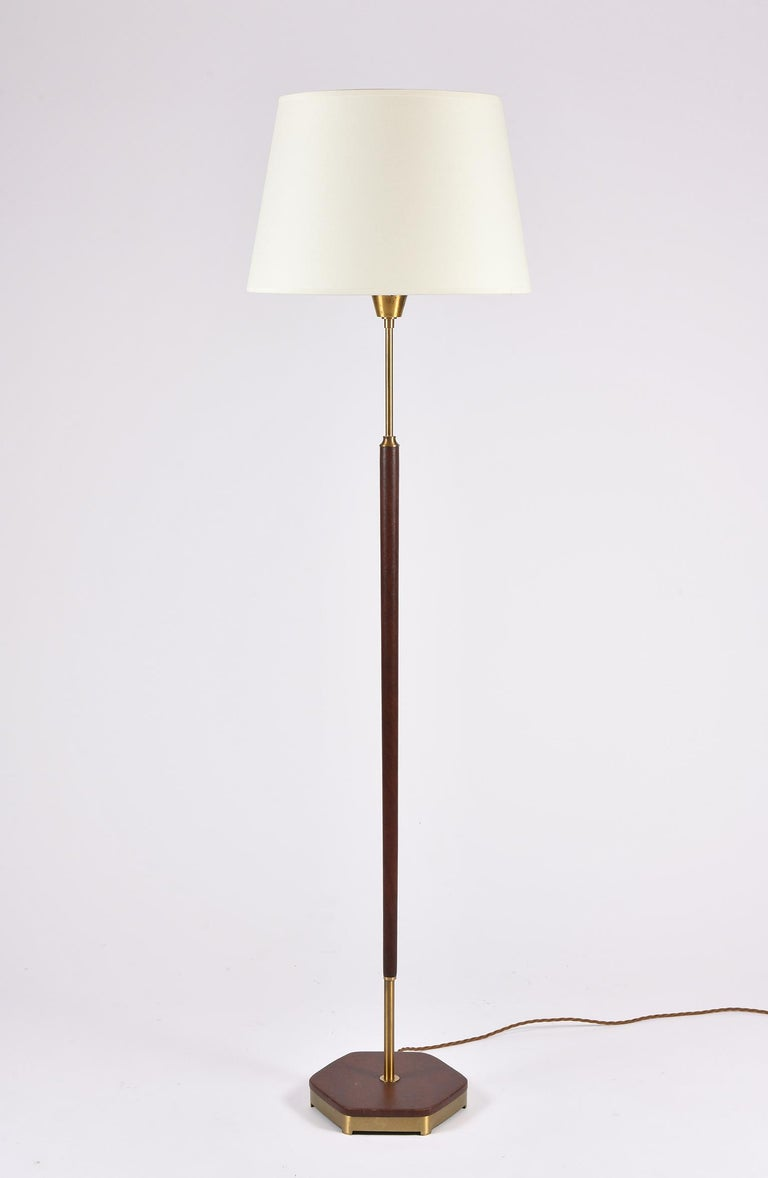 A brass and brown leather floor lamp Sweden, circa 1950.