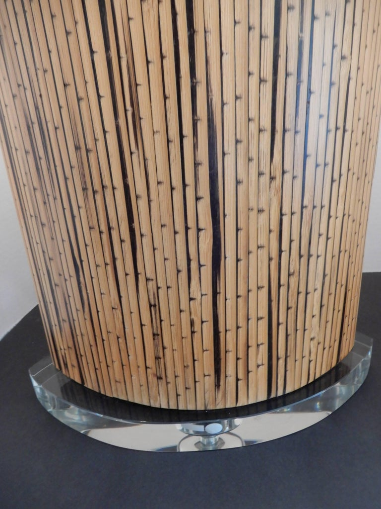 Mid-Century Danish Modern bamboo and Lucite table lamp, with a Lucite base and top and matching original finial. New oval shade, three way switch excellent condition.