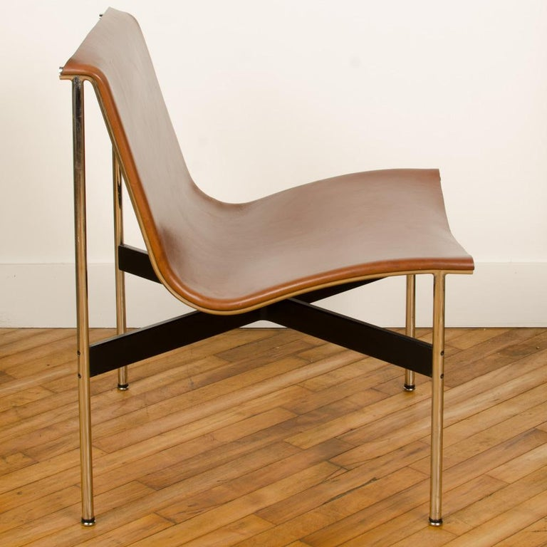 A mid-century designed chair, tan leather with medium antique bronze finish, 1952. Designed by Katavolos Littell, and Kelley in 1952 as part of the original Laverne Collection produced by Gratz. Tan leather, medium antique bronze frame and blackened