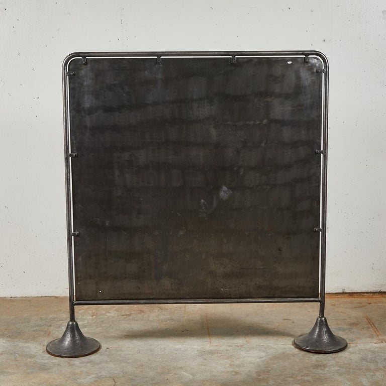 A vintage metal screen acting as a divider or head board. (two available). Originating in France, circa 1950.