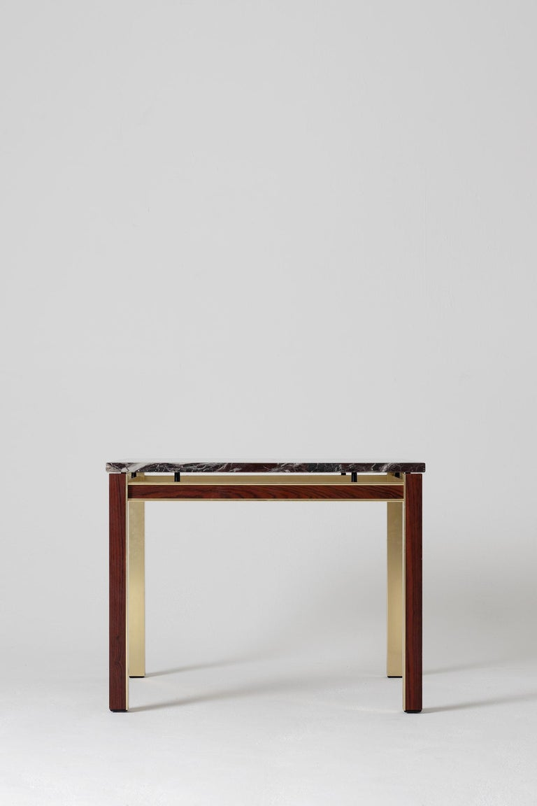 A brass, mahogany and marble top square side table Denmark, circa 1970.