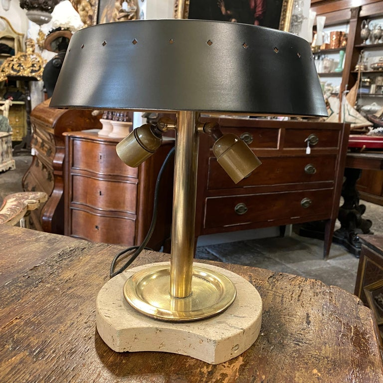 It's a two lights table lamp made in Italy in the Sixties, it works 110-240 volts and need two regular e27 bulbs.
