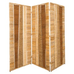 A Midcentury Modern Rattan Tri-Fold Screen or Room Divider.