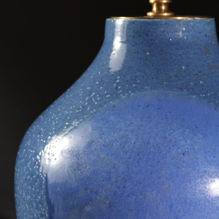 A midcentury art pottery vase with blue glaze in the Japanese taste, now mounted as a lamp.  Please note: Lampshade not included.  Currently wired for the UK. Please enquire for rewiring services.