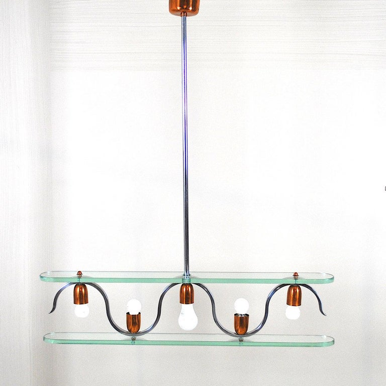 A beautiful midcentury chandelier in crystal and copper in the style of Gio Ponti for  Fontana Arte.