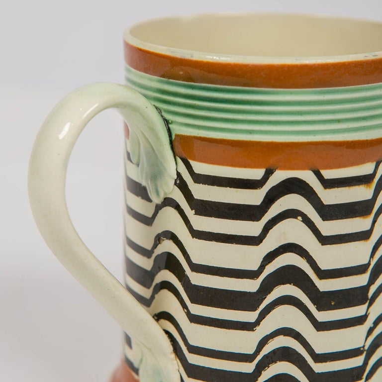 Why We Love It: The design is hypnotic. A Mochaware mug made by J.& R Clews at the Cobridge Factory, England, circa 1820. The design is achieved by the use of a crown cam to create irregular patterns like the black and white pattern seen on this