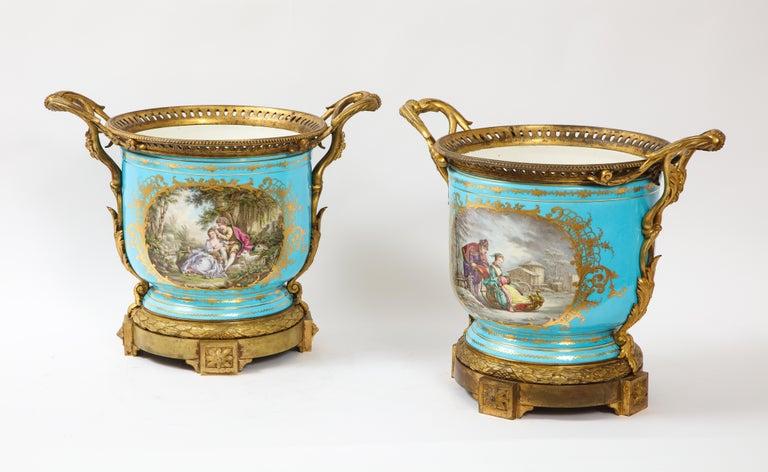 Louis XVI Monumental Pair of 19th Century French Sèvres Celeste Blue Porcelain Cachepots For Sale