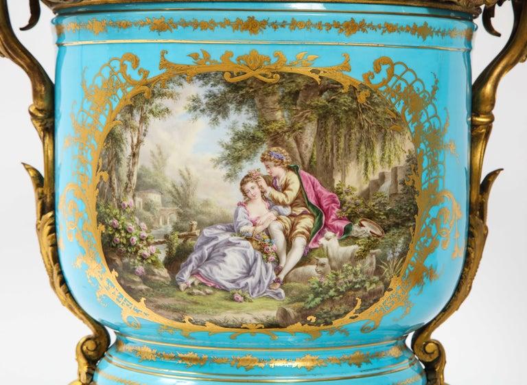 Bronze Monumental Pair of 19th Century French Sèvres Celeste Blue Porcelain Cachepots For Sale