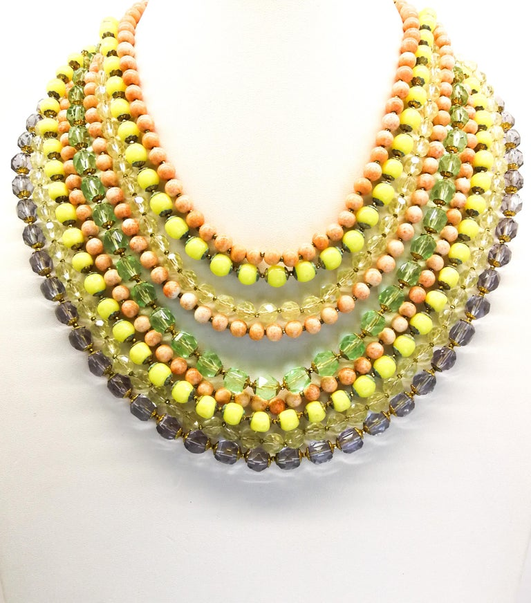 A bright and cheerful large glass bead necklace and matching earrings, with clear faceted and opaque smooth beads, a Summery mix of coral, lemon, citrine , amethyst and mint hues, falling one row loosely on top of the other, from the 1950s. The