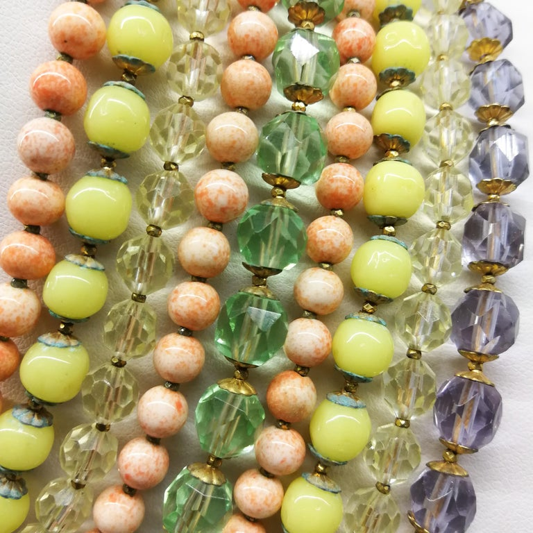 Women's A  multi row, multi coloured glass bead necklace, and earrings, De Mario, 1950s For Sale