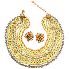 A  multi row, multi coloured glass bead necklace, and earrings, De Mario, 1950s