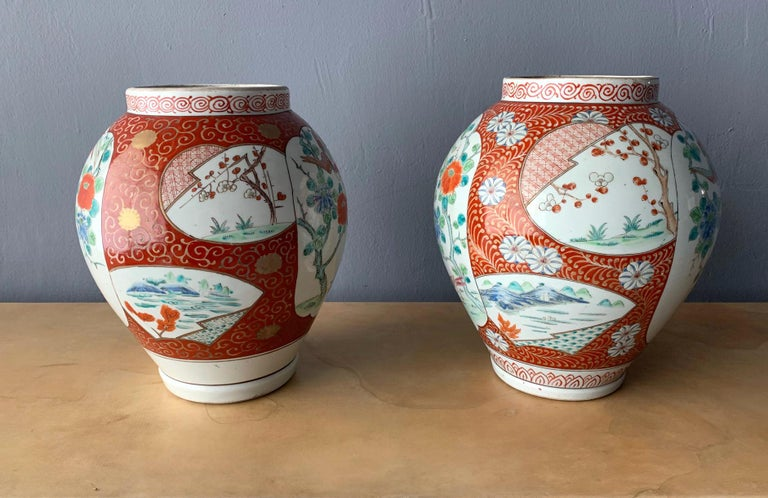 A near pair Hizen pottery jars from Artia Japan, circa mid-19th century of the Meiji Era. Heavy stoneware construction with overglaze enamels that was inspired by Chinese WuCai from Ming dynasty. The lovely patterns depicts flying phoenix over